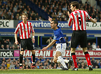 Photo: Aidan Ellis.<br /> Everton v Sunderland. The Barclays Premiership. 01/04/<br /> 2006.<br /> Everton's Leon Osman starts to celebrate his goal as Sunderland's Gary breen and Danny Collins look on