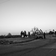 Just near Rosarno, early morning, one of the many collecting points where the farmhands wait every day to get a daily work.
