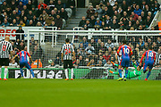Luka Milivojevic (#4) of Crystal Palace scores Crystal Palace's first goal (0-1) from the penalty spot during the Premier League match between Newcastle United and Crystal Palace at St. James's Park, Newcastle, England on 6 April 2019.