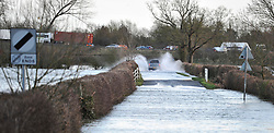 © Licensed to London News Pictures. 08/01/14 Wytham, Oxfordshire. Godstow Road, Wytham in flood on 7th January the day before a cyclist died in these flood waters today (08/01/14) at 1200hrs. Photo credit : MarkHemsworth/LNP