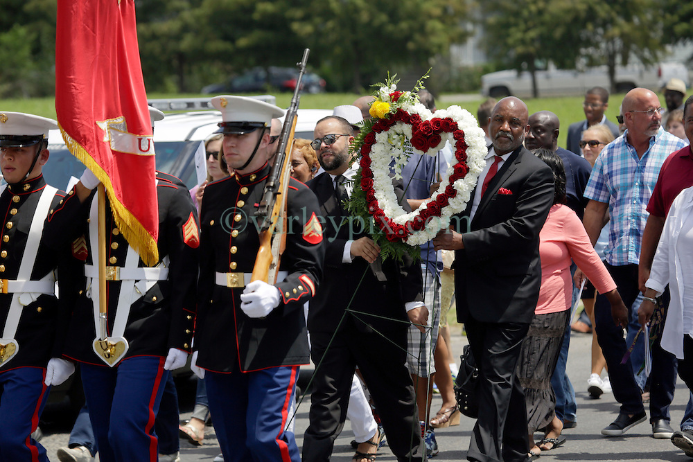 29 August 2015. Lower 9th Ward, New Orleans, Louisiana.<br /> Hurricane Katrina 10th Anniversary.<br /> A Marine honor guard leads politicians and mourners to  the monument dedicated to the victims and survivors of the storm. <br /> Photo credit©; Charlie Varley/varleypix.com.