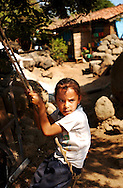 Esbeidi, 6, plays on a rope swing infront of her mud adobe home in Cortijo Viejo, Michoacan, Mexico,  Sunday, May 17, 2003.  Many Mexicans feel forced to enter the U.S., looking for work, including a growing number in the housing industry. (Roberto Gonzalez)