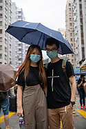 Brother an sister at a protest march in Whampoa, Hong Kong<br />