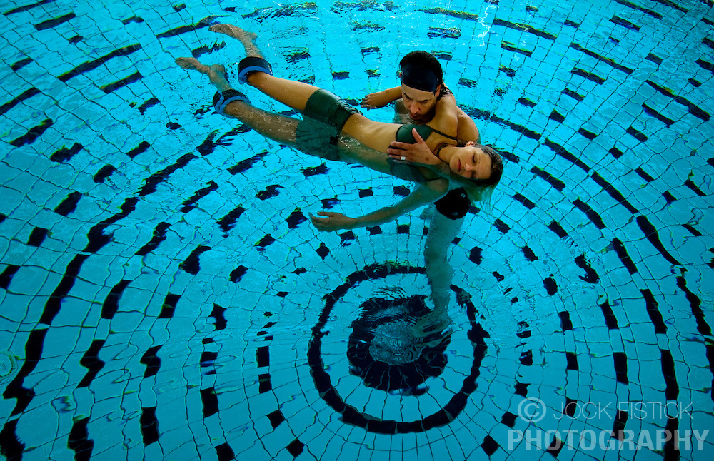 """SPA, BELGIUM - AUGUST-17-2005 -  Matgen and Claire Renaud, of Arlon, Belgium, enjoy a session in the """" Aqua Relax """" pool at Le Thermes de Spa. Health and beauty spas the world over, take their name from the original spa in Spa, Belgium where visitors have been coming for hundreds of years to """" take the waters """" at Les Thermes de Spa  . (Photo © Jock Fistick)"""