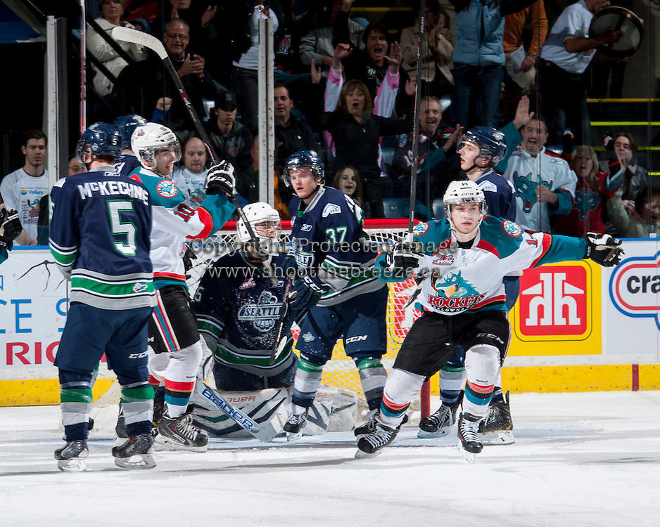 KELOWNA, CANADA - APRIL 3: Rourke Chartier #14 of the Kelowna Rockets celebrates a goal on Taran Kozun #35 of the Seattle Thunderbirds on April 3, 2014 during Game 1 of the second round of WHL Playoffs at Prospera Place in Kelowna, British Columbia, Canada.   (Photo by Marissa Baecker/Getty Images)  *** Local Caption *** Rourke Chartier; Taran Kozun;