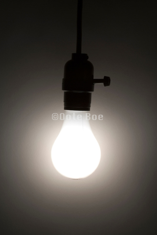 a glowing regular light bulb