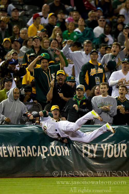 OAKLAND, CA - JULY 05:  Josh Donaldson #20 of the Oakland Athletics dives into the third base tarp to catch a foul ball hit off the bat of Munenori Kawasaki (not pictured) of the Toronto Blue Jays during the eighth inning at O.co Coliseum on July 5, 2014 in Oakland, California. The Oakland Athletics defeated the Toronto Blue Jays 5-1.  (Photo by Jason O. Watson/Getty Images) *** Local Caption *** Josh Donaldson