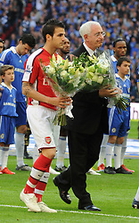 LONDON, ENGLAND - Saturday, April 18, 2009: The Football Association Chairman Lord David Triesman and Arsenal's captain Cesc Fabregas presents flowers to the Hillsborough Family Support Group in memory of the 96 Liverpool supporters who died at an FA Cup Semi-Final 20 years ago in 1989, before the FA Cup Semi-Final match at Wembley. (Photo by Robin Parker/Pool/Propaganda)