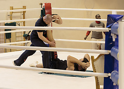 11.11.2015, Stanglwirt, Going, AUT, Wladimir Klitschko, Training, Kampfvorbereitung gegen Tyson Fury (GBR), im Bild v.l. Wladimir Klitschko, Physiotherapeut Aldo Vetere // Trainer Johnathon Banks ( L ) Wladimir Klitschko ( C ) Physiotherapeut Aldo Vetere ( R ) during a training session in front of his Fight against Tyson Fury (GBR) at the Stanglwirt in Going, Austria on 2015/11/11. EXPA Pictures © 2015, PhotoCredit: EXPA/ Johann Groder