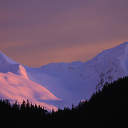 The sun sets over the Southern Chugach Range near Cordova Alaska