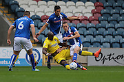 AFC Wimbledon striker Tom Elliott (9) and Rochdale FC defender Jim McNulty (4) tussle during the EFL Sky Bet League 1 match between Rochdale and AFC Wimbledon at Spotland, Rochdale, England on 27 August 2016. Photo by Stuart Butcher.