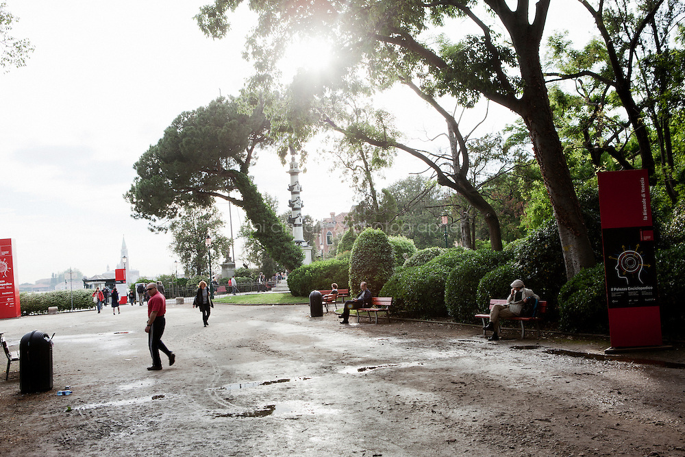 VENICE, ITALY - 31 MAY 2013: People walk by the the Giardini of the Biennale at the end of the day after the closing hour of the exhibitions, in Venice, Italy, on May 31st 2013. <br /> <br /> <br /> The 55th International Art Exhibition of the Venice Biennale takes place in Venice from June 1st to November 24th, 2013 at the Giardini and at the Arsenale as well as in various venues the city. <br /> <br /> Gianni Cipriano for The New York TImes