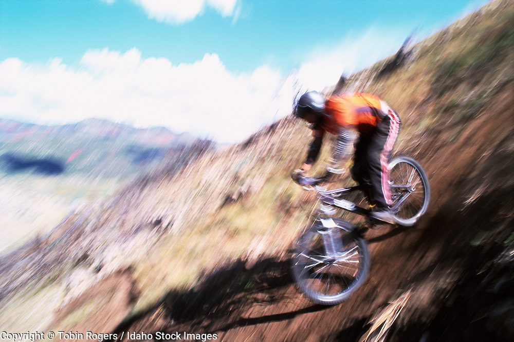 Idaho. Motion blur of mountain biker going downhill.