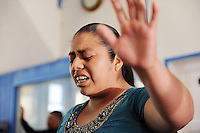 A parishioner at Fuente de Vida Church loses herself in prayer during Easter Sunday services in Salinas.