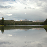 Near Tuolumne Meadows, Dog Lake is a small lake surrounded by woods rather than granite hills. Neaby the lake is Lembert Dome which overlooks the meadows and the Tuolumne River. The treeless granite dome has a sheer west face, 300 feet high, that becomes less steep on the other three sides.  It is a popular destination for hiking which brings many people also to Dog Lake.
