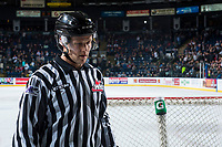 KELOWNA, CANADA - MARCH 31: Linesman Dustin Minty exits the ice after first period between the Kelowna Rockets and the Kamloops Blazers on March 31, 2017 at Prospera Place in Kelowna, British Columbia, Canada.  (Photo by Marissa Baecker/Shoot the Breeze)  *** Local Caption ***