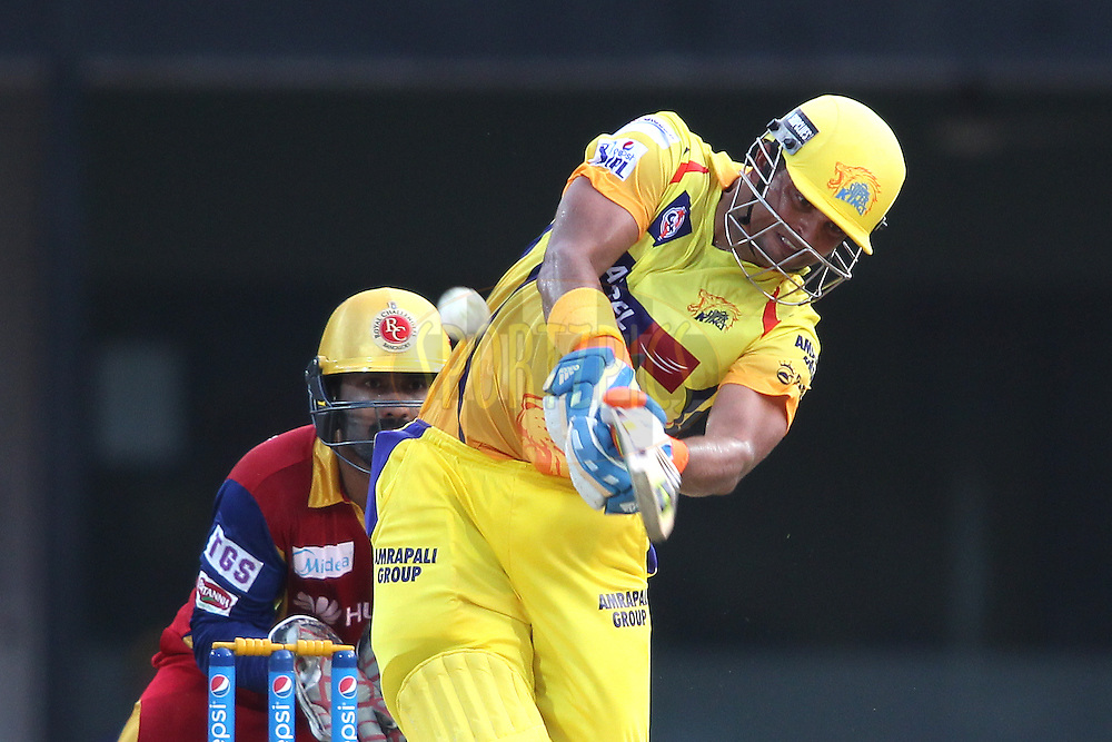 Suresh Raina of Chennai Super Kings hits over the top for six during match 37 of the Pepsi IPL 2015 (Indian Premier League) between The Chennai Superkings and The Royal Challengers Bangalore held at the M. A. Chidambaram Stadium, Chennai Stadium in Chennai, India on the 4th May April 2015.<br /> <br /> Photo by:  Shaun Roy / SPORTZPICS / IPL