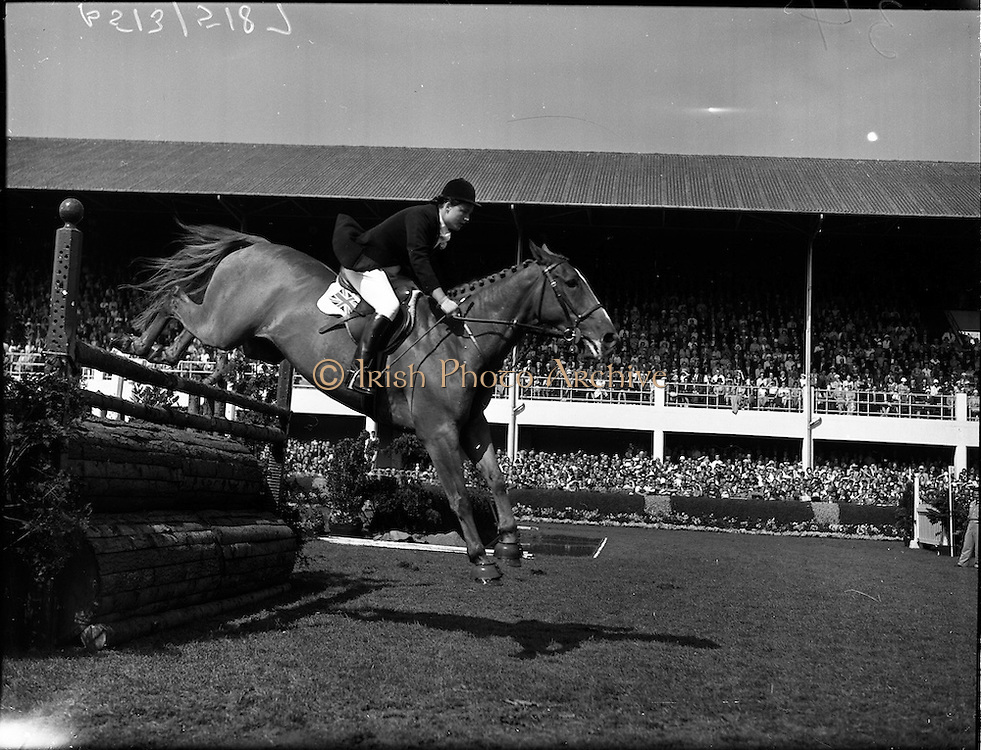 "05/08/1960<br /> 05/08/1960<br /> 05 August 1960<br /> R.D.S Horse Show Dublin (Friday). Aga Khan Trophy. Miss Pat Smythe on ""Flanagan"", competing for English Team in the Aga Khan Trophy International Jumping Competition at Dublin Horse Show."