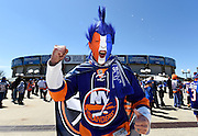 New York Islanders fan Joe Alfeo of Ronkonkoma, N.Y., painted his face for all 30 games he attended this season including Game 6 of a first-round NHL Stanley Cup hockey playoffs against the Washington Capitals at Nassau Coliseum on Saturday, April 25, 2015, in Uniondale, N.Y. (AP Photo/Kathy Kmonicek)