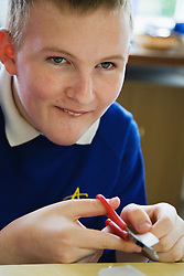 Pupil with learning difficulties in lesson in special school,