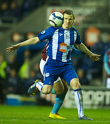 WIGAN, ENGLAND - Tuesday, March 16, 2010: Wigan Athletic's Gary Caldwell in action against Aston Villa during the Premiership match at the DW Stadium. (Photo by David Rawcliffe/Propaganda)