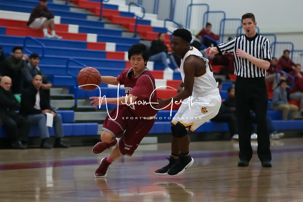 (Photograph by Bill Gerth for SVCN) Cupertino #3 Koshi Huynh drives to the hoop vs. Mission San Francisco boys basketball in the Fukushima Basketball Tournament at Independence High School, San Jose CA on 12/7/16.  (Mission San Francisco 52 Cupertino 47)