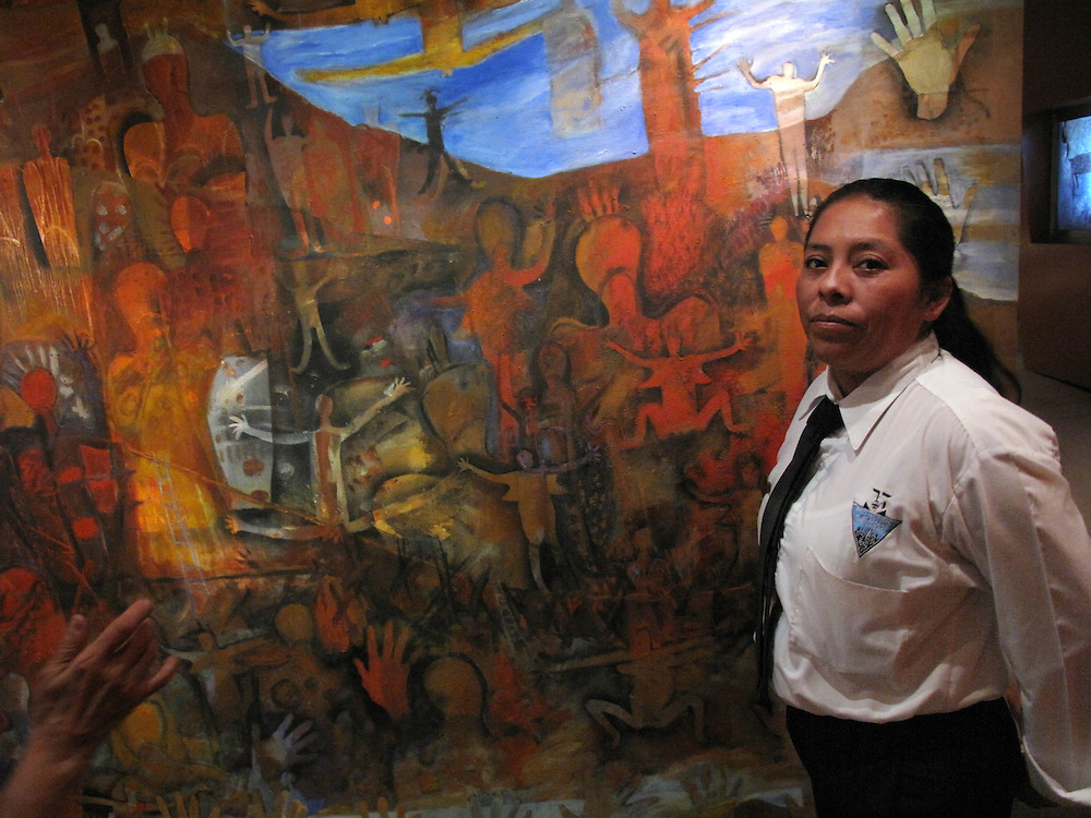 Tijuana Mexico ..A museum guard in front of a mural by Marta Palau at the modern CECUT (Centro Cultural Tijuana). Marta is one of Mexico's formost artists, she lives both in Tijuana and Mexico City..While working on this long term project 'La Frontera' I want to examine the cultural and humanitarian activities on both sides of a border that keeps the United States and Mexico apart with a wall of steel already 600 miles long. The turf wars of drug cartels, arms trafficking and rampant kidnappings turned cities like Tijuana into some of the most dangerous places on earth. Despite the violence many brave artists, photographers, architects, poets, humanitarians, teachers etc live and work in the shadow of the wall on both sides and have a positive influence on this region; they are the focus of my long term project along the border. (Over time I plan to cover the entire length from the Atlantic to the Pacific, these images were taken in and around Tijuana).© Stefan Falke