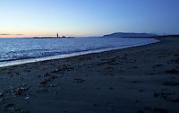 Beach with Grotta lighthouse in the background