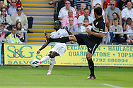 Swansea city's Nathan Dyer (l) scores his sides 3rd goal.  Pre-season friendly match, Swansea city v FC Stuttgart at the Liberty Stadium in Swansea, South Wales on Saturday 11th August 2012. pic by Andrew Orchard, Andrew Orchard sports photography,