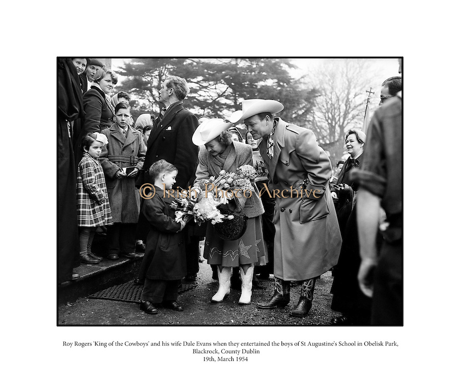 """Roy Rogers 'King of the Cowboys' and his wife Dale Evans when they entertained the boys of St Augustine's School in Obelisk Park, Blackrock, Co. Dublin.19/03/1954..Roy Rogers, born Leonard Franklin Slye (05/11/1911 - 06/07/1998), was an American singer and cowboy actor, one of the most heavily marketed and merchandised stars of his era, as well as being the namesake of the Roy Rogers Restaurants franchised chain. He and his wife Dale Evans, his golden palomino, Trigger, and his German Shepherd dog, Bullet, were featured in more than 100 movies and The Roy Rogers Show. The show ran on radio for nine years before moving to television from 1951 through 1957. His productions usually featured a sidekick, often either Pat Brady, (who drove a Jeep called """"Nellybelle""""), Andy Devine, or the crotchety George """"Gabby"""" Hayes. Rogers's nickname was """"King of the Cowboys"""". Evans's nickname was """"Queen of the West.""""."""