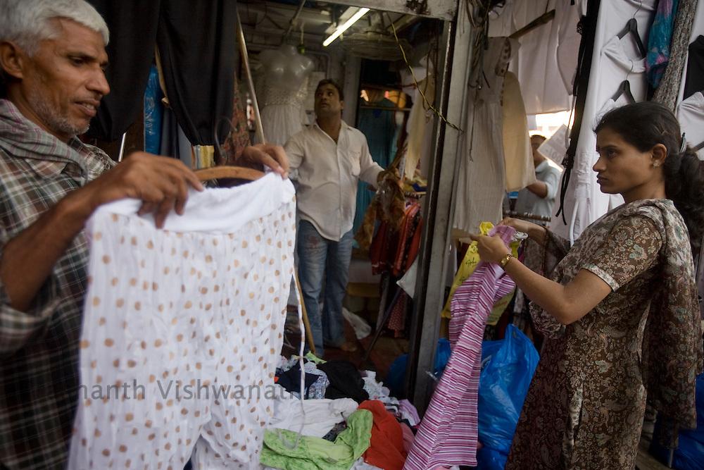 People shop on a street in Mumbai, on Sunday Dec. 28, 2008.  Photographer:Prashanth Vishwanathan
