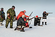 Canadian Rangers patrol rides snowmobiles for a shooting drill next to their camp in Baring Bay on Devon Island, Nunavut, during Nunalivut 2012 sovereignty exercise in arctic Canada. 20 April 2012. At this time they were equipped with antediluvian Lee Enfield rifles that were later replaced with more modern weaponry. But as shown, uniform regulations are pretty laxly enforced as Inuits Rangers wisely complement army issued clothings with seculars furs and animal skins, still unmatched by synthetic fibers.<br />