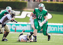 Sep 6, 2015; Huntington, WV, USA; Marshall Thundering Herd quarterback Michael Birdsong runs out of the pocket during the first quarter against the Purdue Boilermakers at Joan C. Edwards Stadium. Mandatory Credit: Ben Queen-USA TODAY Sports