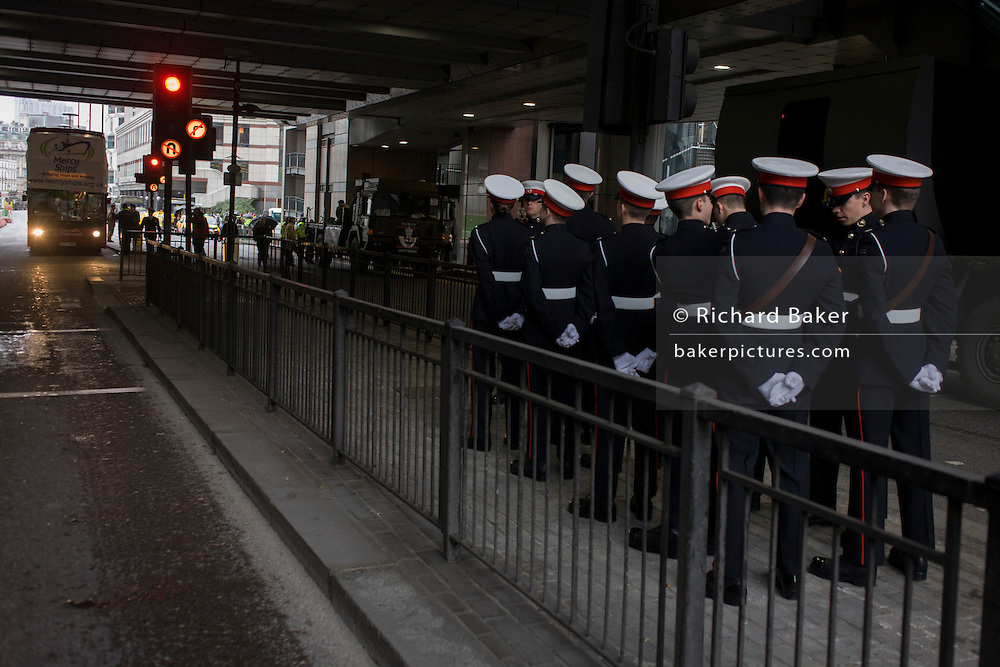 London 14th November 2015. Soldiers gather before the Lord Mayor's Show in the City of London, the capital's ancient financial district founded by the Romans in the 1st Century. This is the pageant's 800th birthday and the 250 year-old horse-drawn guided State Coach will be pulled through the medieval streets with the newly-elected Mayor along with 7,000 others. This first took place in 1215 making it the oldest and longest civil procession in the world which survived both Bubonic plague and the Blitz. Richard Baker / Alamy Live News