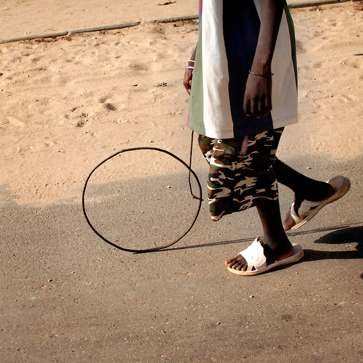 Senegal October 25, 2006 -  Child playing with a toy he's made. ©Jean-Michel Clajot