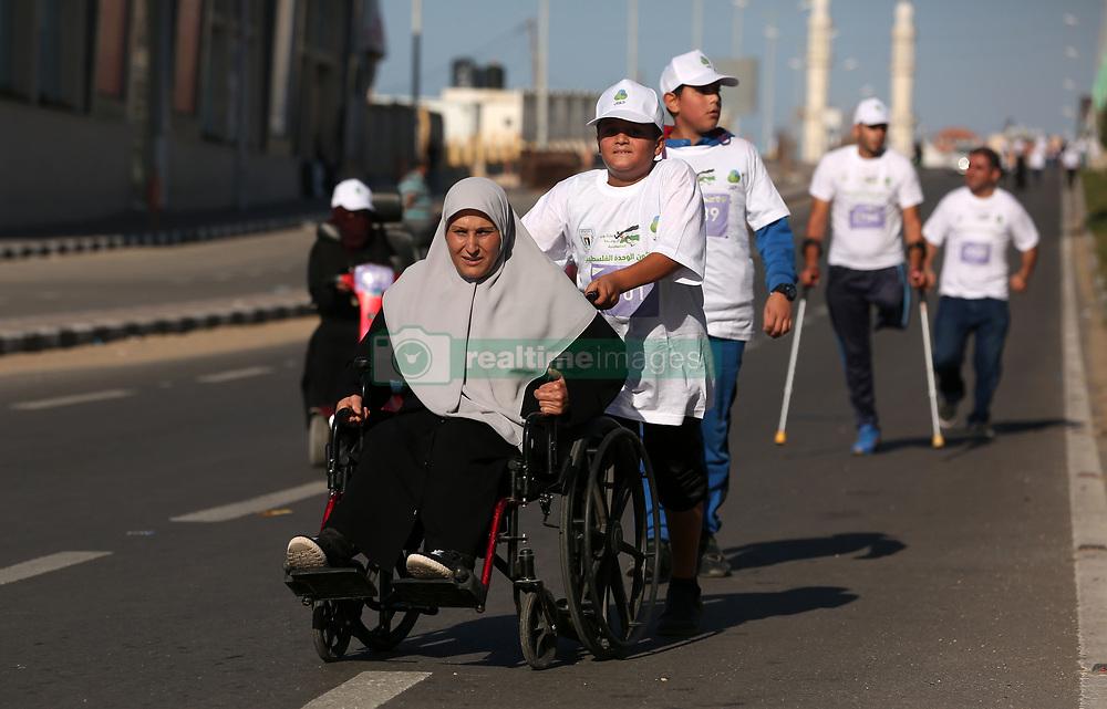 November 10, 2017 - Gaza, gaza strip, Palestine - Handicapped Palestinians participate in a ''national unity marathon'' organised by the Palestine Athletic Federation to support national reconciliation, in Gaza City on November 10, 2017. (Credit Image: © Majdi Fathi/NurPhoto via ZUMA Press)