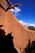 Wooden beams and adobe wall in the mission church at Peco Pueblo, Pecos National Historic Park, New Mexico