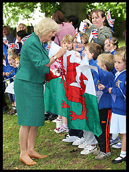 The Duchess of Cornwall meets local schoolchildren during a visit to Brecon Cathedral in Wales, Tuesday 10th July 2012.  Photo by: Stephen Lock / i-Images