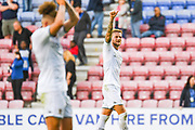 Leeds United defender Liam Cooper (6) reacts to winning 2-0 away at Wigan during the EFL Sky Bet Championship match between Wigan Athletic and Leeds United at the DW Stadium, Wigan, England on 17 August 2019.