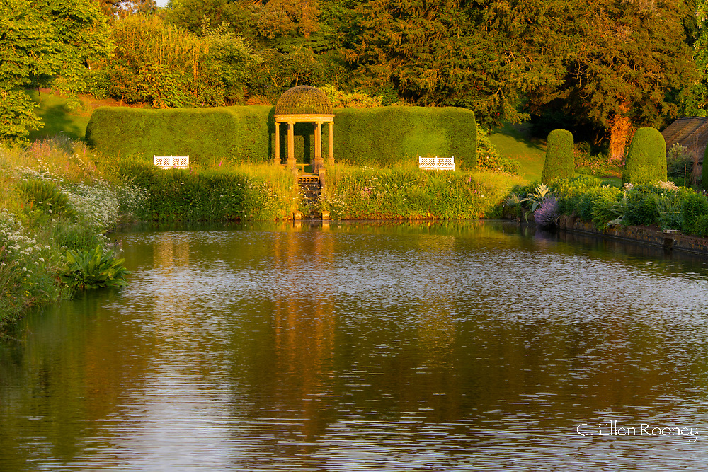 The Ionic Temple at the head of the long pond in early sunlight at Forde Abbey, Chard, Dorset, UK