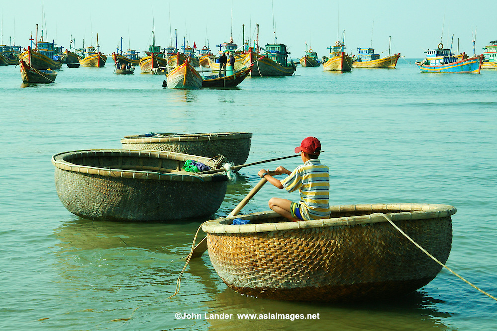 """Vietnamese basket boats are used as ferries to go out to the main fishing boats and back to shore.  These baskets are also sometimes used for artfully displaying """"catch of the day"""" at seafood restaurants once they have retired from service as boats."""
