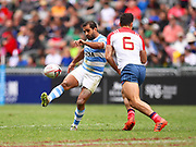 Argentina player Gaston Revol kicks the ball forward to gain ground during the game Argentina vs France during the Cathay Pacific/HSBC Hong Kong Sevens festival at the Hong Kong Stadium, So Kon Po, Hong Kong. on 7/04/2018. Picture by Ian  Muir.