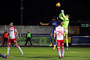 AFC Wimbledon striker Jake Jervis (10) battles for possession with Stevanage goalkeeper Paul Farman (1) during the EFL Trophy group stage match between AFC Wimbledon and Stevenage at the Cherry Red Records Stadium, Kingston, England on 6 November 2018.