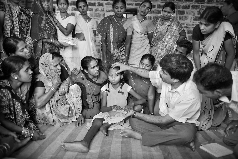 Dr. Yogesh Jain demostrates patient examination procedure on a young volunteer. Watching are some of the more than one hundred village health workers trained by the JSS who provide a frontline service. These health workers, all of them women, are selected by their home villages. They must be prepared to visit each and every household in their village regardless of caste of religion. <br />