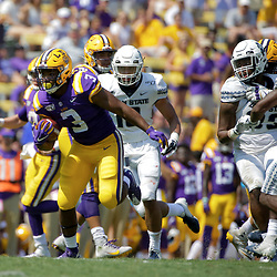 Oct 5, 2019; Baton Rouge, LA, USA; LSU Tigers running back Tyrion Davis-Price (3) runs against the Utah State Aggies during the first half at Tiger Stadium. Mandatory Credit: Derick E. Hingle-USA TODAY Sports