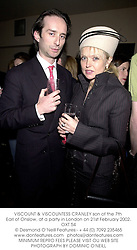 VISCOUNT & VISCOUNTESS CRANLEY son of the 7th Earl of Onslow, at a party in London on 21st February 2002.	OXT 54