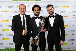 Liverpool's Mohamed Salah and sponsors pose with the PFA Player Of The Year Award Trophy during the 2018 PFA Awards at the Grosvenor House Hotel, London