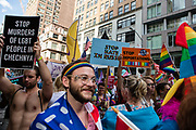 New York, NY - 25 June 2017. New York City Heritage of Pride March filled Fifth Avenue for hours with groups from the LGBT community and it's supporters. Marchers protest the deportation of undocumented immigrants, and the anti-gay policing in Russia and Chechnya.