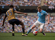 Kevin De Bruyne of Manchester City (right) gets past Alex Iwobi of Arsenal during the Barclays Premier League match at the Etihad Stadium, Manchester<br /> Picture by Russell Hart/Focus Images Ltd 07791 688 420<br /> 08/05/2016