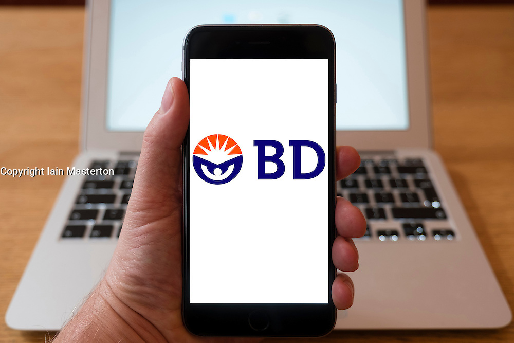 Using iPhone smartphone to display logo of BD, Becton Dickinson, American medical technology company